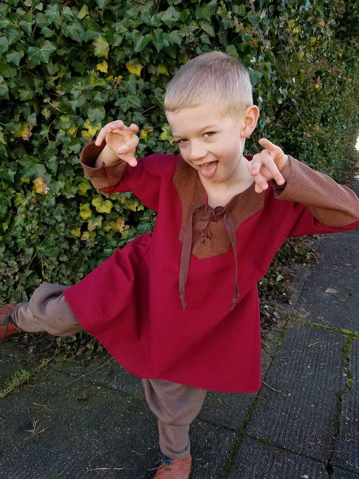 James, A red and brown boys tunic.