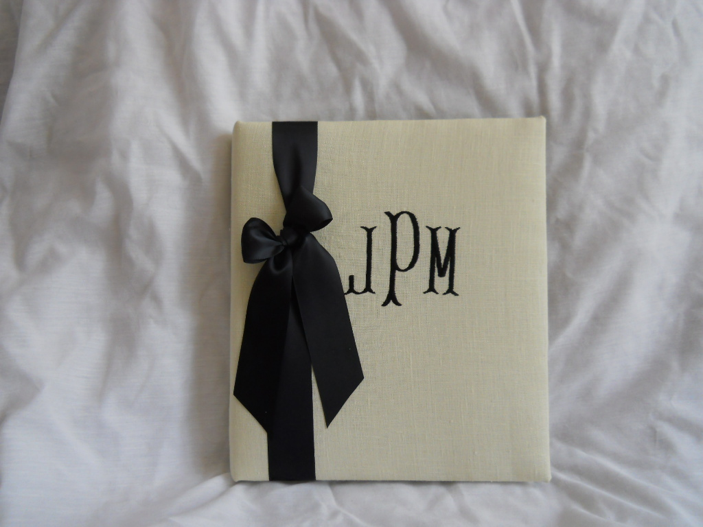 Susie, bone linen monogrammed wedding book available at; https://www.waycooldesigns.com