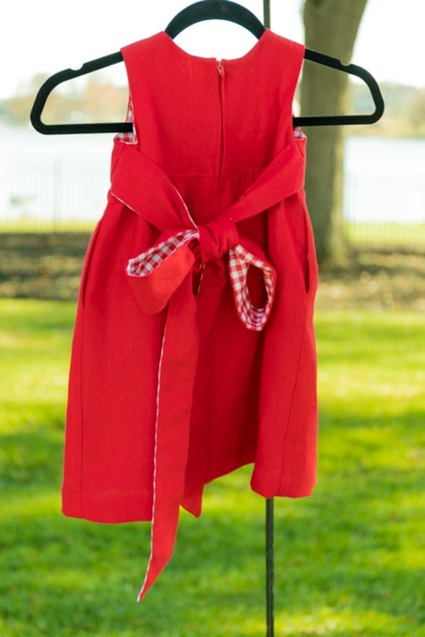 Gigi, This little girls dress is made from heavyweight linen, 4C22 Crimson.  I added the bow and side poc...