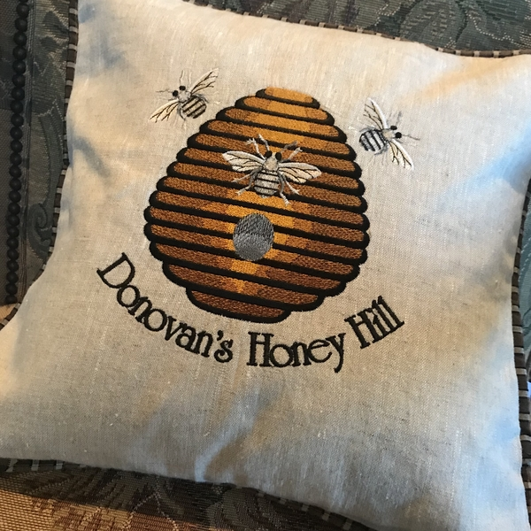 "Rebecca, Custom Embroidered 16"" square pillow depicting Honeybee Farm. The design is embroidered on medium we..."