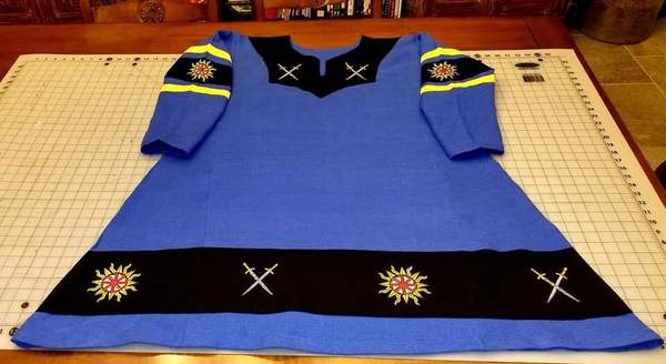 Michelle, Viking Tunic, for the Atenveldt Cut-n-Thrust Champion, 2018. Embroidered with Suns and Crossed Sword...