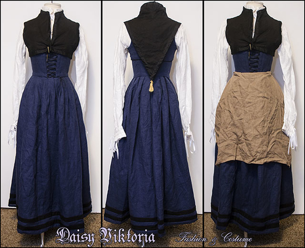 Daisy, 16th century Flemish gown in blue linen with black linen contrasting bands, worn with a black linen...