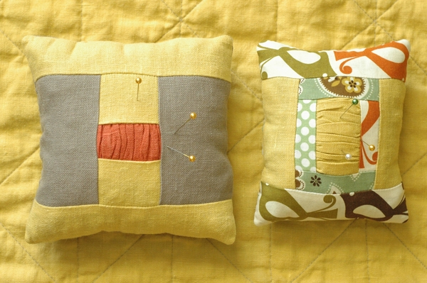 Lana, Pincushions made from linen solids and a cotton print.