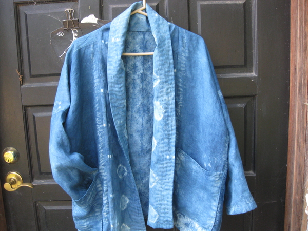 Holly, This is a lightweight 5.3 oz linen.  I scoured it.  Stitched it with Shibori designs and indigo dyed...