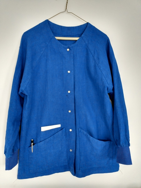 SUSAN, Custom raglan sleeve scrub coat with pocket details for accessories in royal blue.