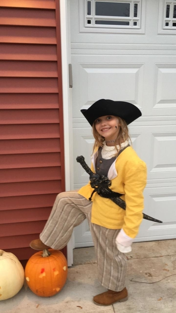 Teresa, This pirate is wearing a self lined vest in IL019 Graphite.  The lined jacket is of IL019 Mimosa.  T...