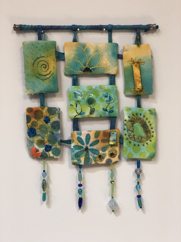Mary, I use white linen from Fabric-Store.com to make my designs- I color the linen with Alcohol Inks  whi...