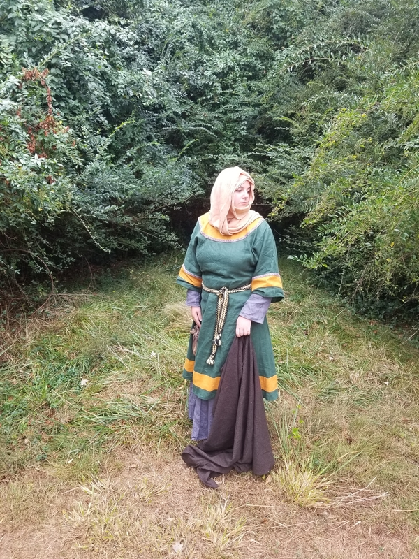 Chelsey, A reproduction of an 11th century Anglo-Saxon woman. Made of emerald green linen with gold trim, wor...