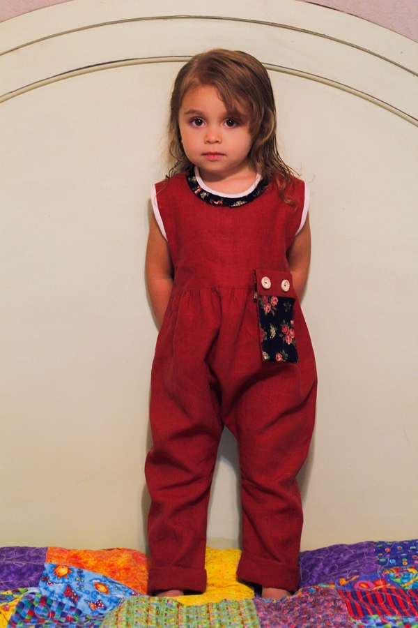 judy, Romper in Deep Claret with contrasting linen binding, neck ruffle and detachable pocket.  Other pock...