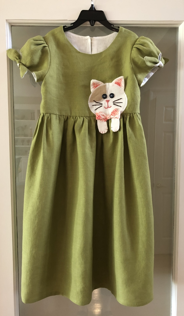 JOY, Cat dress for my grand daughter using a Simplicity pattern.  IL019 Oasis Softened fabric was so easy...