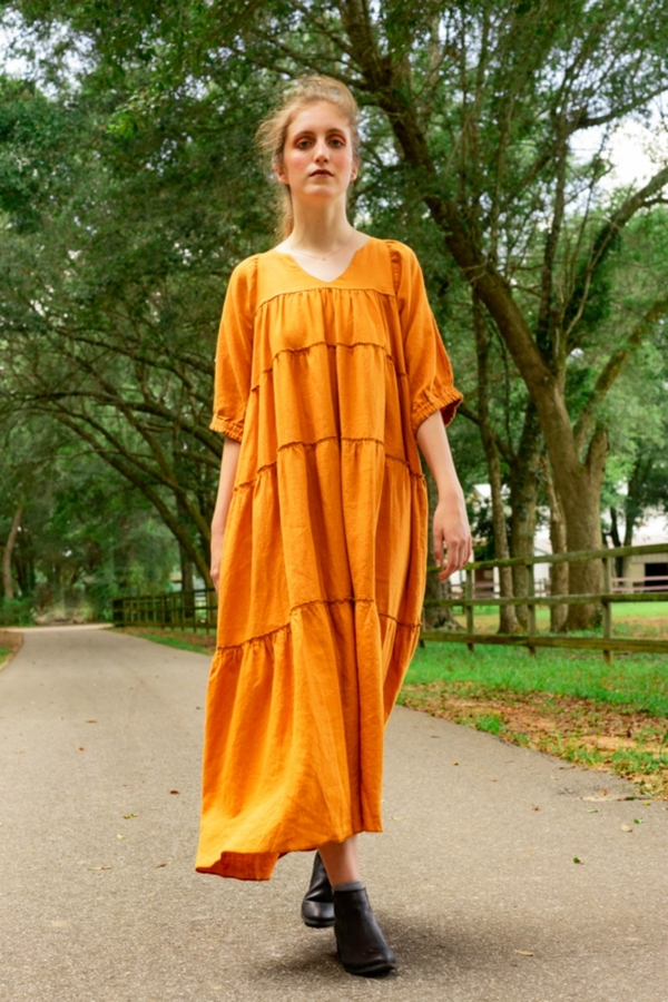 Becky  , Maxi length dress with v-neck, 3/4 sleeves and tiered panels.