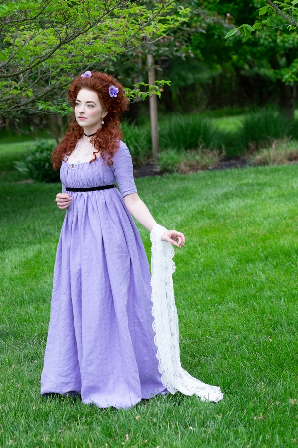 Kelly, This late 1790's round gown is made from a woven patterned linen. It is secured with drawstrings, an...