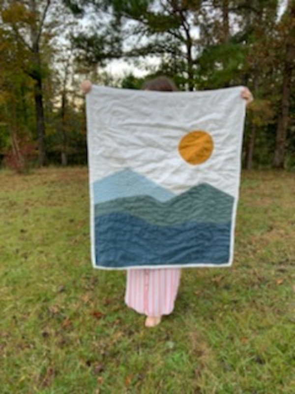 Mercy, Hand quilted baby quilt with a Mountain View.