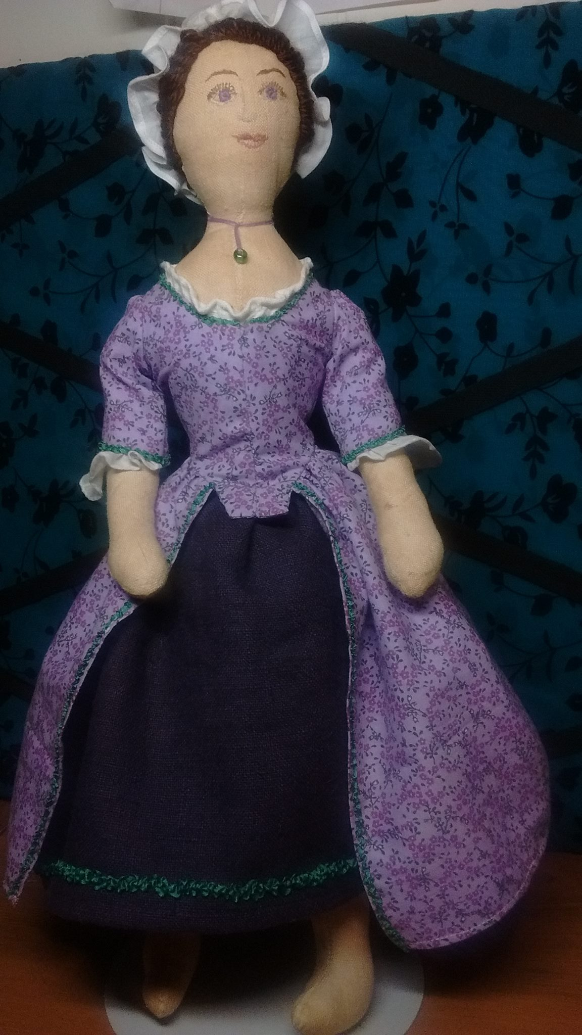 Hilary, This lavender lady is a 16 inch, 18th Century doll. Her body is tea dyed linen. Her face is hand emb...