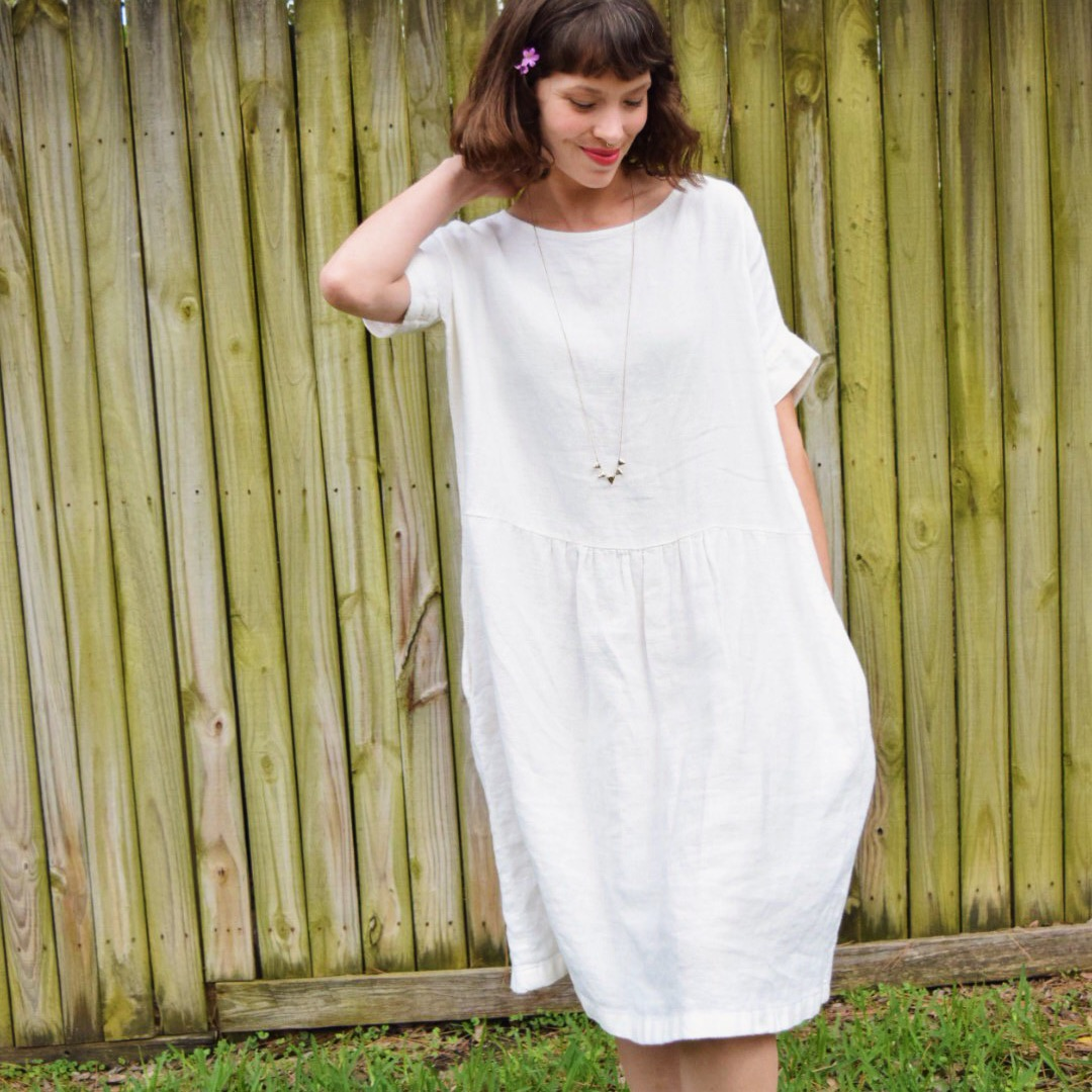 Randee, Gathered dress w inseam pockets and cuffed sleeves made with heavy weight bleached.