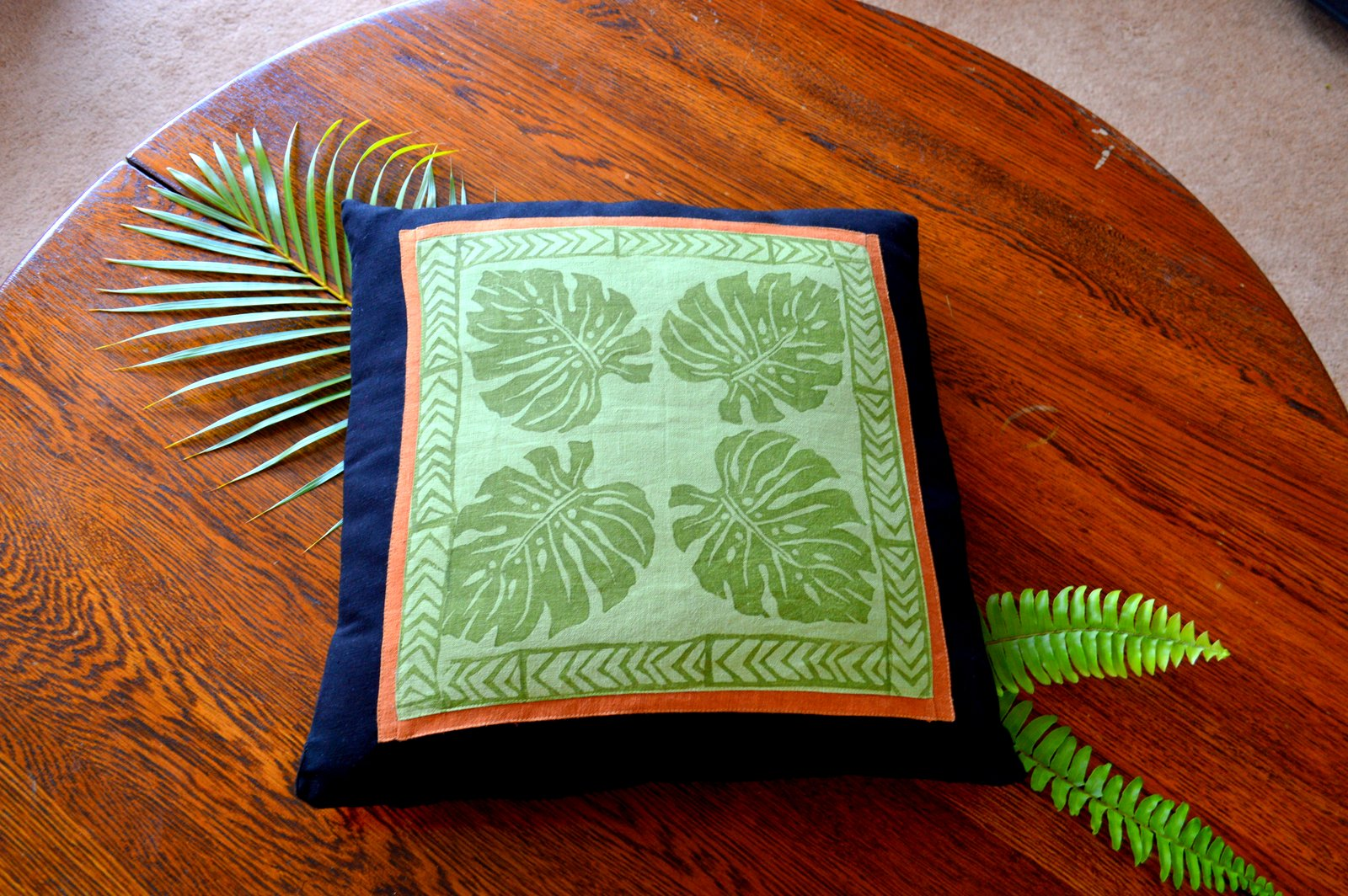 Lesley, Hand printed monsteria leaf  linen cushion cover from hand carved wooden stamps .