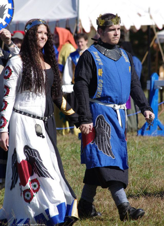 Nicole, This a heraldic cotehardie and fighting tunic for His Grace Valharic and myself.  The other side of...