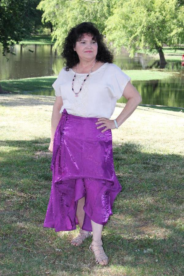 Synthia, I sewed up the Designer Stitch Kat Blouse out of a linen blend fabric and sewed a lace applique. A...