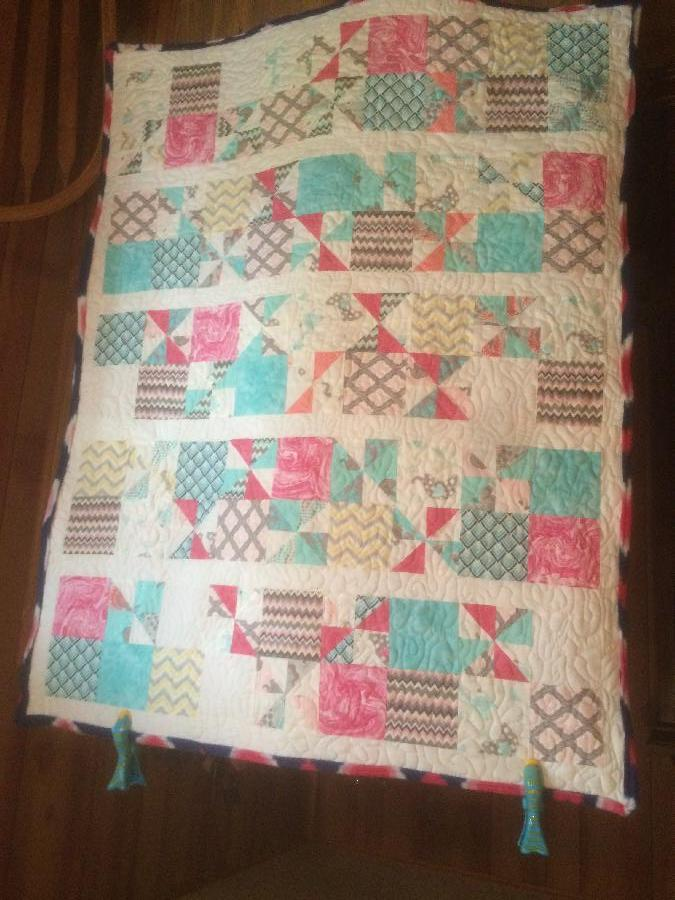 Krystal, Crib size quilt made for a very special Lady for her baby girl. Free motion quilted it.