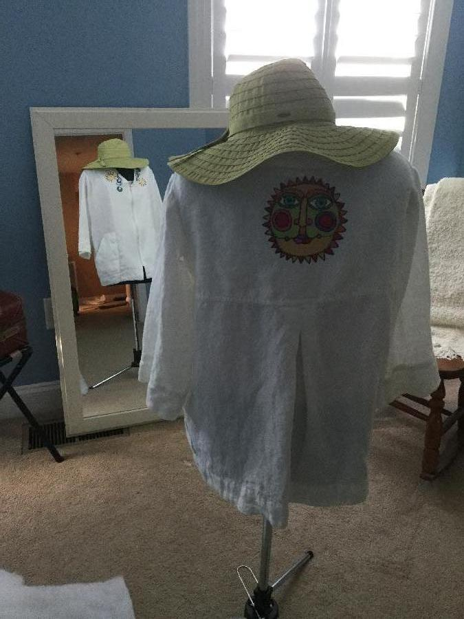 Kathy, This is a Beach coverup. The linen fabric was a dream to embroidery on. The top has a front zipper,...