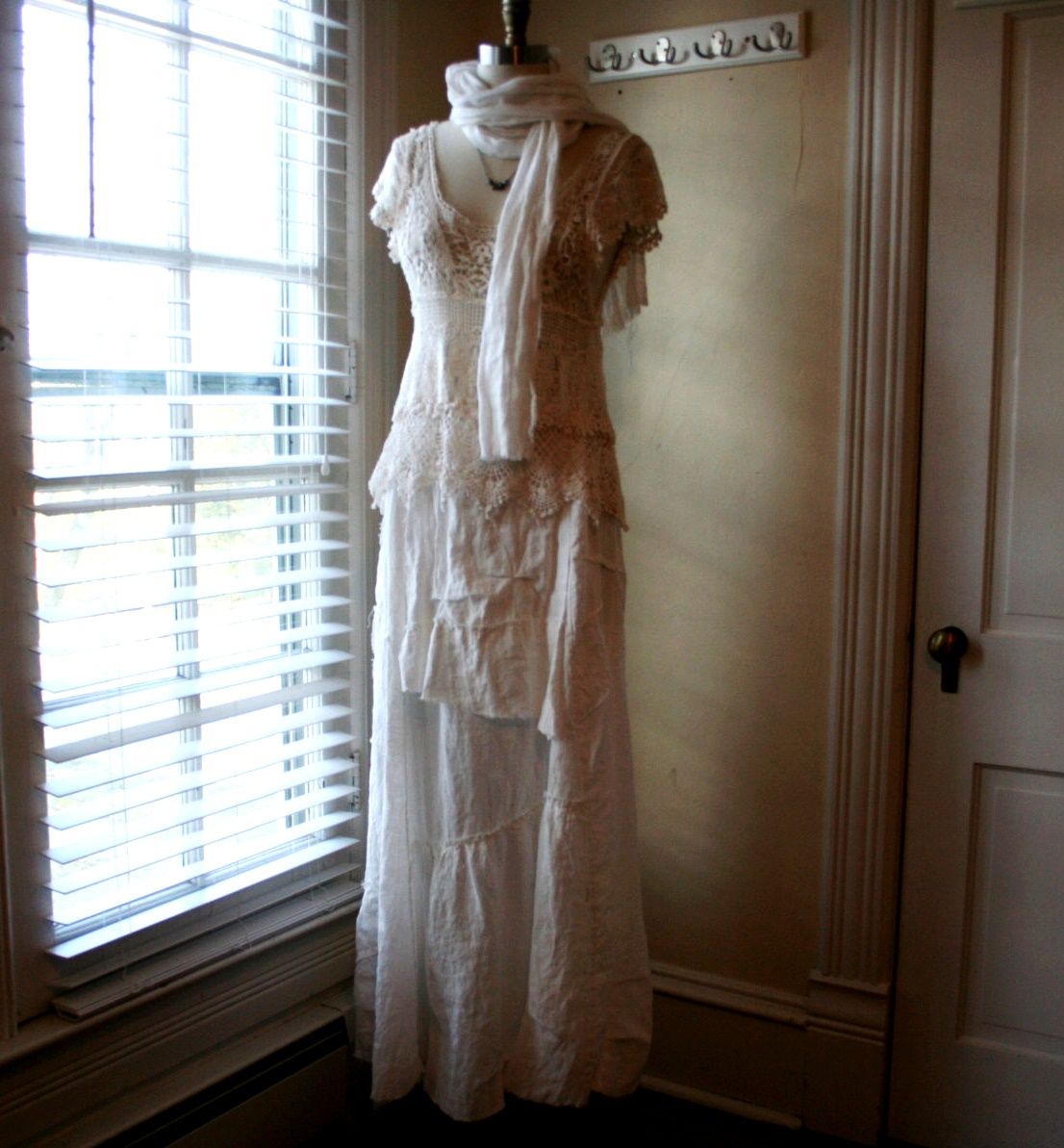 Beth, Boho Wedding Dress, created using primarily handkerchief Linen. The romantic linen skirt features an...