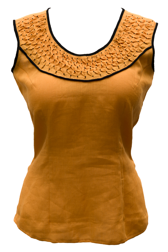 Janaki, I made this top (IL020 Autumn Gold softened) with hand-smocking on a bias strip in the yoke. To make...