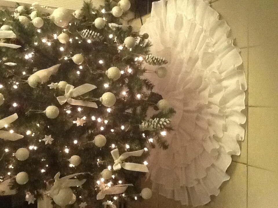 Paul, Ruffled christmas tree skirt, all white heavy linen five ruffles in a overlapping ruffle design.