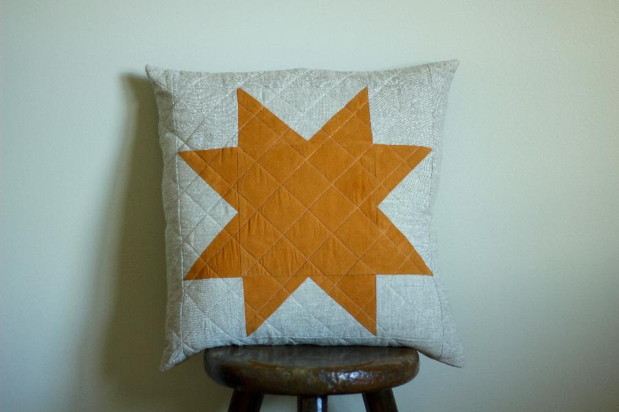 Rebekah, Dyed cotton star with Marigold flowers, on a backdrop of quilted mix-natural linen ( my favourite).