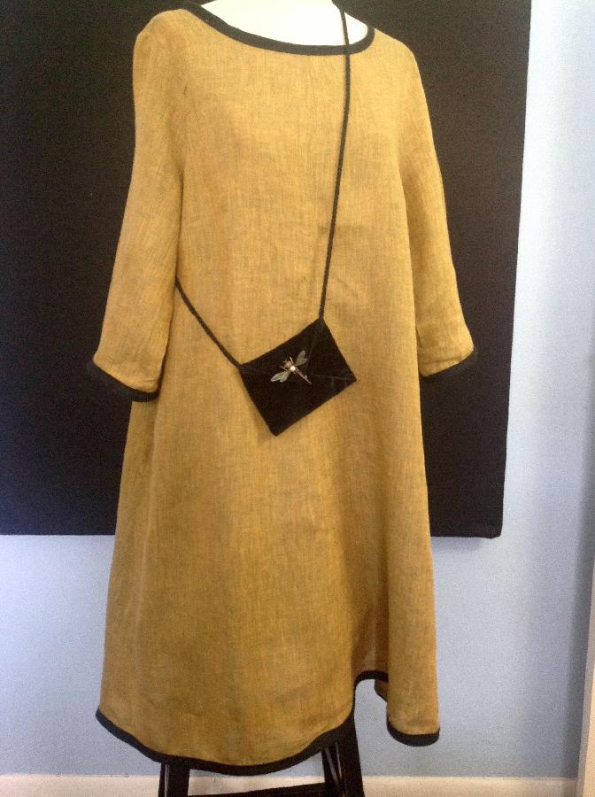 Susan k, Pullover flared dress of yarn dyed linen bound in black linen improvised from NEW LOOK SO443 pattern...