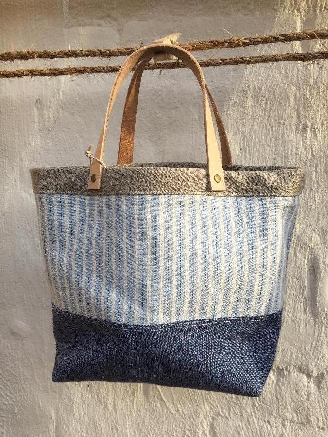 Gina, Bucket tote bag in three linen fabrics w/ veg. tanned leather handles and antique brass rivets : tri...