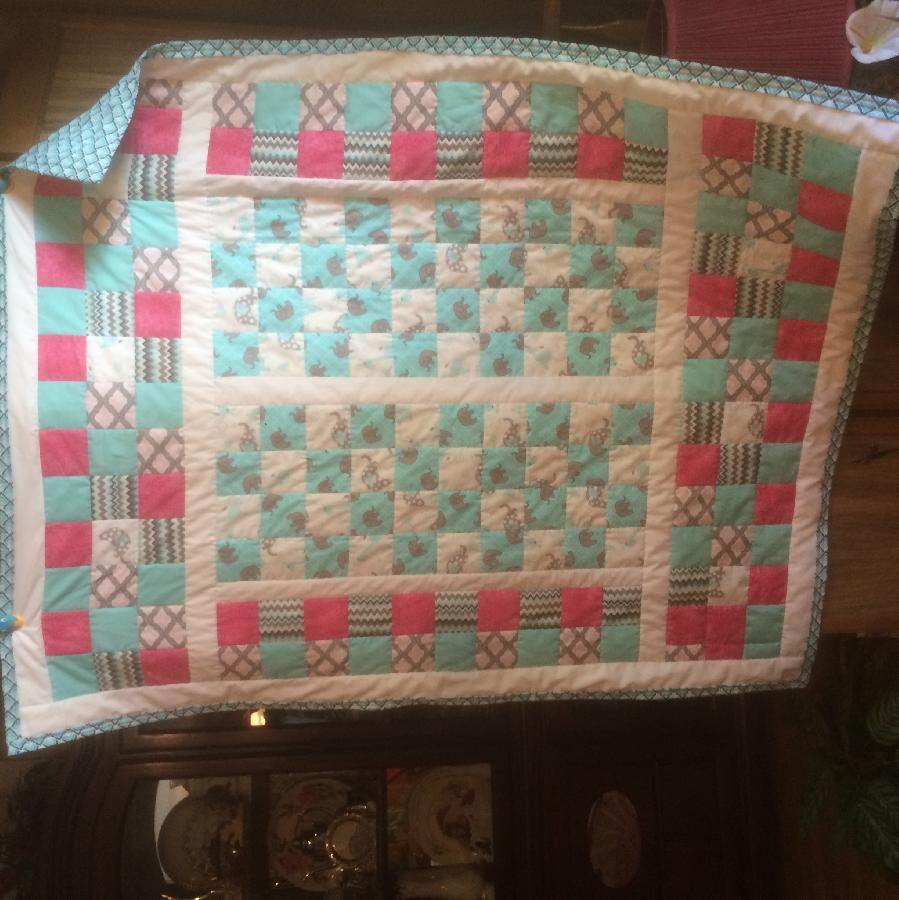Krystal, throw cover size girls quilt for a special little girl finished it with in the ditch.