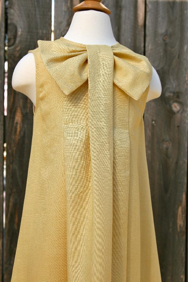 Samuelle, Hi, this is my big bow,  100% pure linen dress. I created this dress for one of my clients who was p...