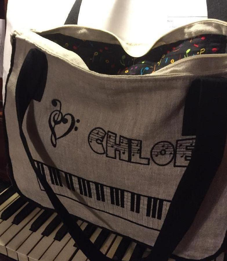 Theresa, PIANO BAG  made with natural and black linen, lined with music note print cotton.