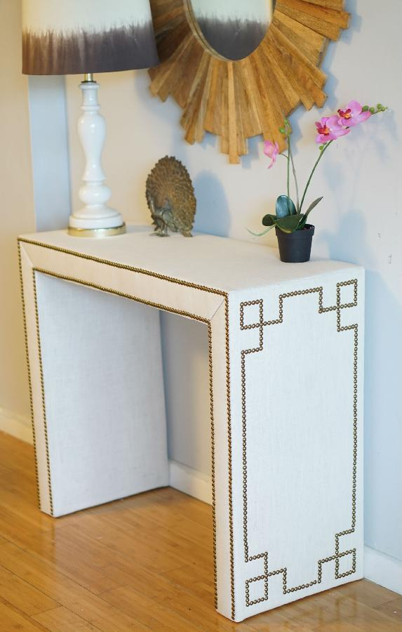 Alexis, Custom made console table wrapped in linen with nail heads in a Greek Key design!