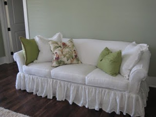 Debbie, Ruffled bleached white washed linen sofa slipcover with ruffled skirt and self cording detail.  Sepa...