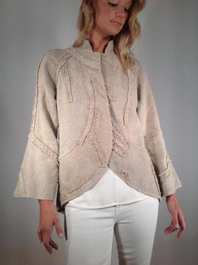 Peter, Linen jacket with free form appliqués.The applied design is cut on bias by stitching with a sewing m...