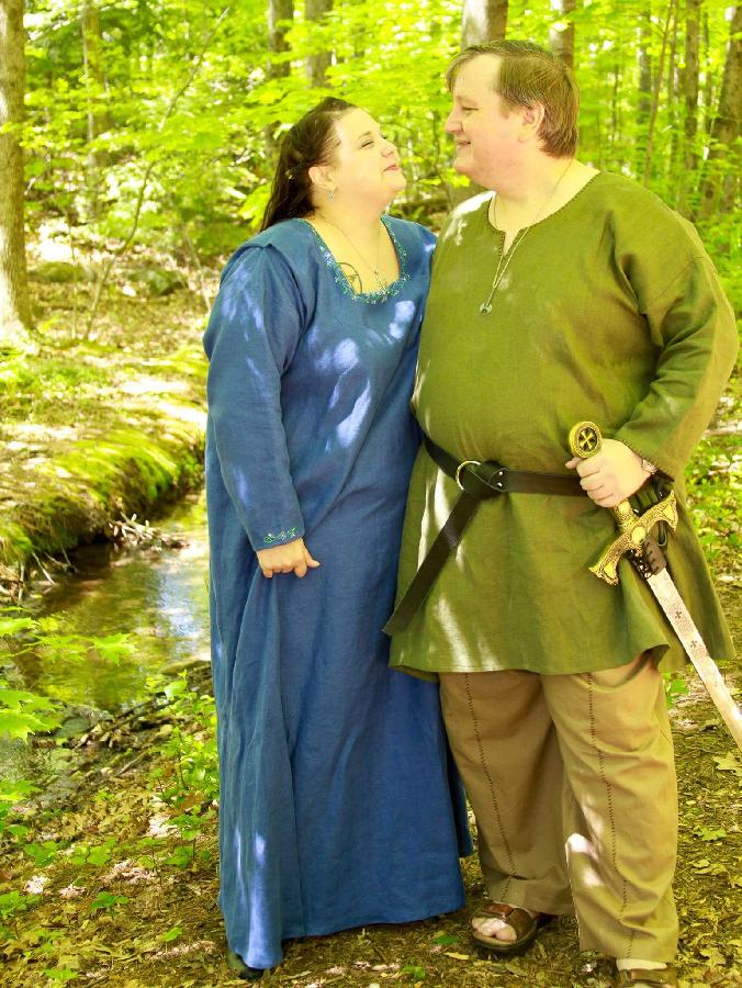 Kristina, Viking womens kirtle and mens tunic and trousers.  The kirtle is decorated with hand embroidered d...