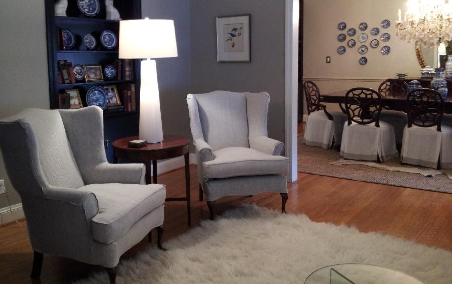 Jeanne, Wing chair slipcovers with flat flange outlining and dining room chair skirts in white and mixed nat...