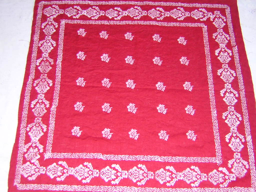 Laura, This is a red medium weight linen cut into a 34 x 34 scarf and hand printed in a white design. The...