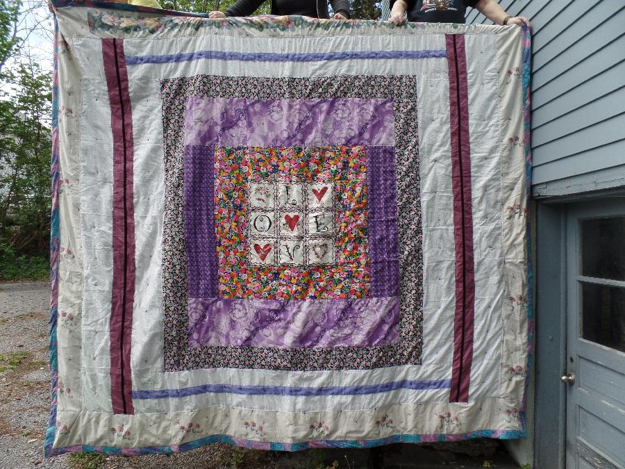 Doris, the  front of a king size quilt I made in 2016  all out of used material items bought at use store o...