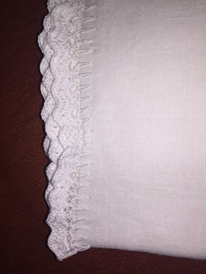 Claudia, Linen pillowcases with hand crocheted lace edges.  These were a wedding gift for my cousin.