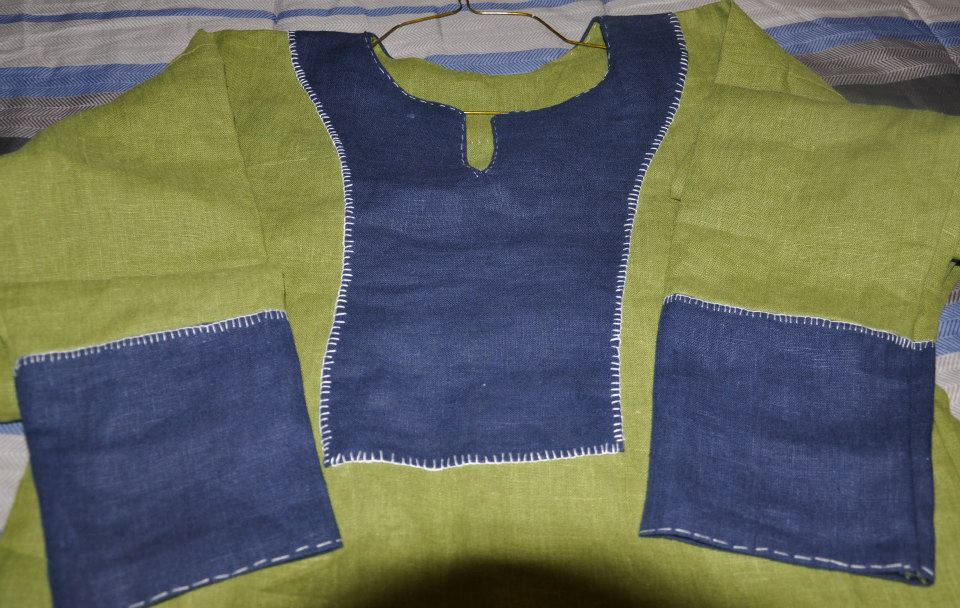Judi, Viking outer tunic.  Made with Green 100% linen and Cobalt Blue 100% linen.  Top stitching is done i...