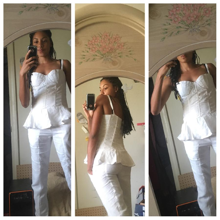 Yasmin, A detailed view of my white shelled bustier top with matching slim fit pants.