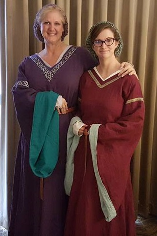 Rachel, Medieval Bliaut dresses.  Made with IL019: Royal Purple with Sphinx for sleeve lining, and Wild Cher...