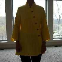 The yellow mid weight linen was perfect for this Vogue pattern top.  I found the perfect buttons...