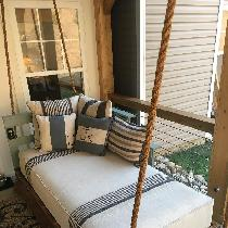 My swinging porch bed adorned with a combination of 4C22 Mixed natural, 4C22 Bayou Blue and vari...