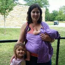 A ring sling to wear my baby! She was also nursing in this photo, hence the tail covering her an...