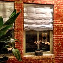 Sheer greenish blue linen Roman shades, lined with white for my new home in an old but renovated...