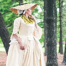 This polonaise, petticoat and stomacher are all hand finished out of cream linen. The handkerchi...