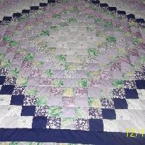 this is a queen size quilt I made for my aunt for Christmas. I used 41/2 in. squares starting wi...